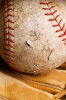 well-used softball in mitt photo
