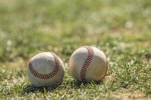 Two Baseball Lying on the Grass