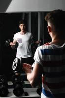 man with dumbbells. photo