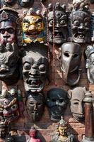 Woodcarving masks hang, Nepal
