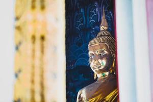thai golden buddha statue in wat temple