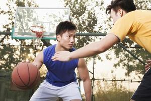 Two street players on the basketball court photo