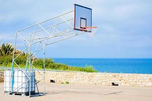basketball hoop by the sea photo