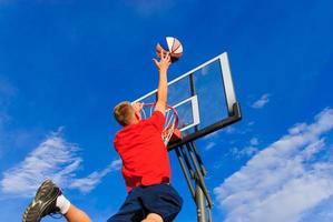Teen puts ball in basket