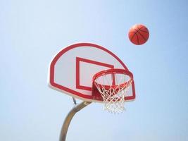 Basketball hoop and ball photo