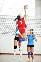girls playing volleyball indoor game photo