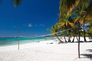 Volleyball net on tropical beach photo