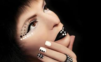 Makeup and manicure with rhinestones. photo