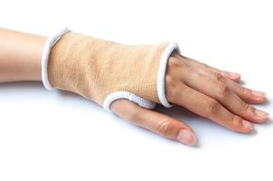 Close-up hand splint for broken bone treatment isolated on white photo