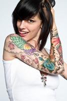 Girl with brown hair and tattoos in white dress photo