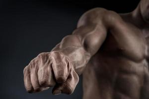 Close-up of athletic muscular arm and core photo