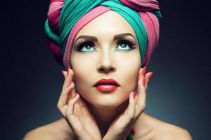 Young woman wearing a colorful turban photo