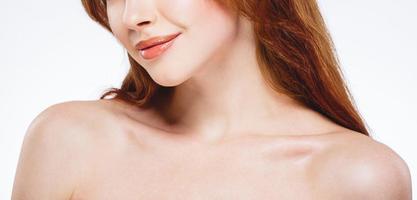 Beautiful woman face close up portrait happy studio on white