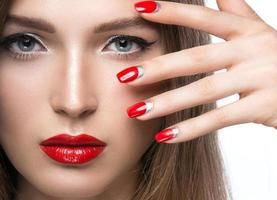 Beautiful young girl with a bright make-up and red photo