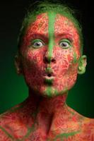 emotional woman with red multi lines and green hair