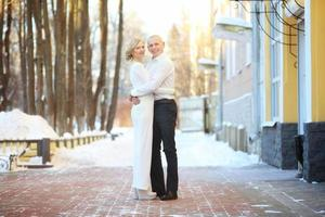 winter wedding the couple on the street outside photo