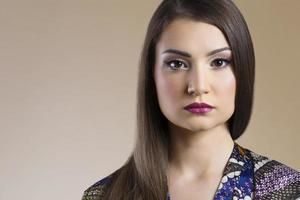Portrait of a beautiful asian woman with neutral face photo