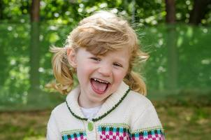 happy blond girl laughing