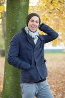 Male fashion model laughing outdoors photo