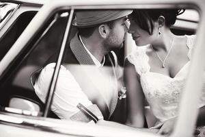 Wedding couple in car photo