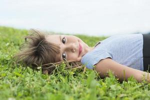 Beautiful portrait of a little girl outside on grass photo