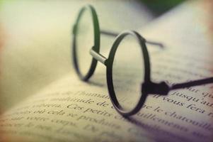 Digital art, glasses on open book (french words) grunge