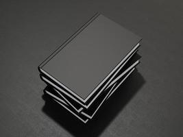 algunos libros con tapa negra en blanco