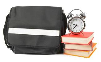 School backpack, books and alarm clock. photo