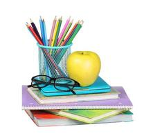 Back to school. An apple, colored pencils and glasses photo