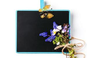 Chalkboard with flowers photo