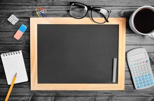 Empty chalkboard with office supply