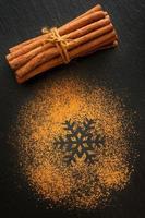 Cinnamon on black chalk board. photo