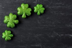 Green Clover on Chalkboard Background photo