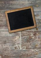 Empty chalkboard on wooden surface photo