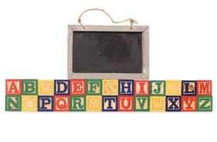 alphabet building blocks with chalkboard