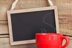 Black chalk board and coffee cup photo