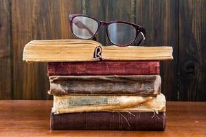 Vintage reading glasses on the books