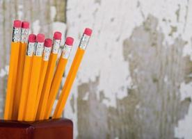 Yellow pencils in pencil holder photo