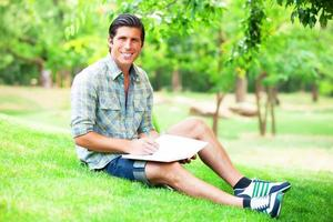 Young student with note at outdoor photo