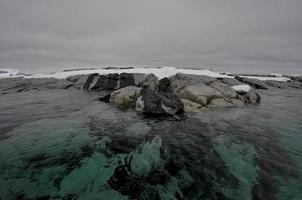 Interesting rock formation in Antarctica water photo