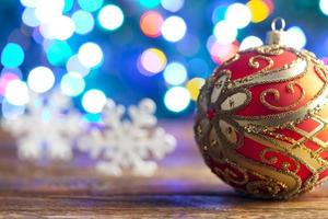 Christmas bauble and snowflakes on lighting background