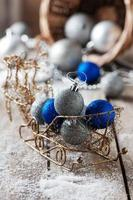 Christmas blue and silver balls on the wooden table