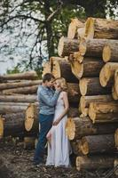 Walk of a newly-married couple about logs