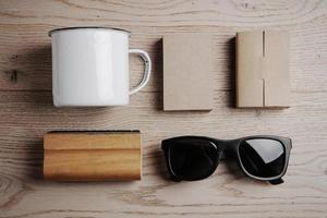 Top view of a office elements, sunglasses, cup on the