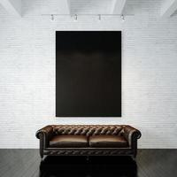 Photo of black empty canvas on the painted brick wall