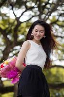 Asia young cute woman smile white  bouquet  flowers