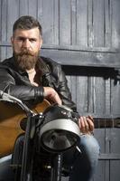 Biker man with guitar photo