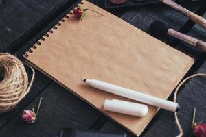 Blank paper mockup with artist brushes on wooden table photo