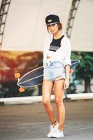 Fashion lifestyle, beautiful young woman with longboard
