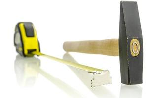 Tape measure and hammer photo